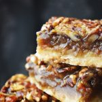 pecan pie bars close up image showing the sweet filling in detail